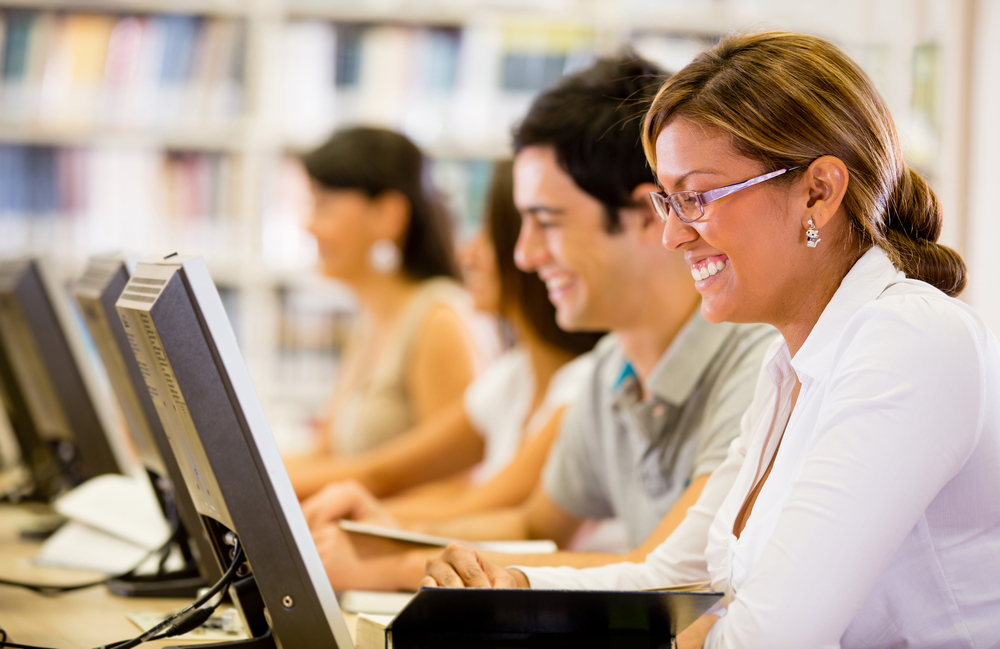 Students researching online at the library on computers